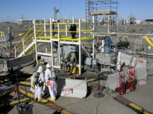 Workers check the area near the tank where a radioactive leak occurred on July 27th at the Hanford Nuclear Reservation.